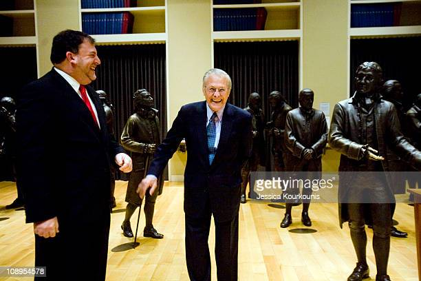 Former US Secretary of Defense Donald Rumsfeld jokes with President and CEO of the National Constitution Center David Eisner inside the center where...