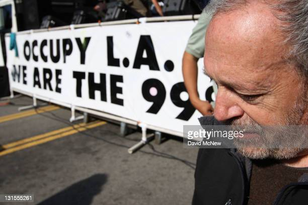 Former U.S. Secretary of Labor Robert Reich awaits his introduction to speak to Occupy Los Angeles protesters after the Move Your Money March through...