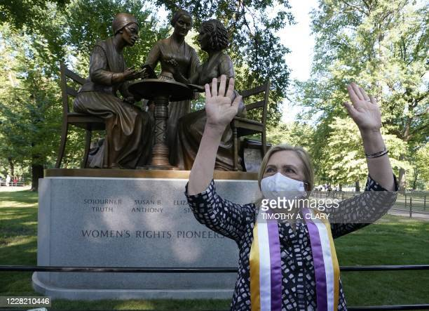 Former US Secretary of State and former presidential candidate Hillary Clinton poses after the unveiling of the statue of women's rights pioneers...
