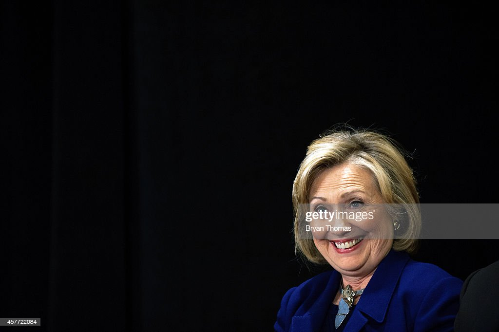 Former U.S. Secretary of State and U.S. Sen. Hillary Rodham Clinton smiles while Incumbent New York Governor Andrew Cuomo speaks during a 'Women for Cuomo' campaign event on October 23, 2014 at the Grand Hyatt Hotel in New York, NY. Cuomo was joined by Clinton who, citing his record on women's rights, endorsed him in the upcoming gubernatorial election on November 4, 2014. U.S. Rep. Kathy Hochul, the Democratic nominee for New York Lt. Gov., also spoke at the event.
