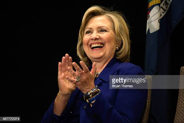 Former US Secretary of State and US Sen Hillary Rodham Clinton applauds while incumbent New York Governor Andrew Cuomo speaks during a 'Women for...