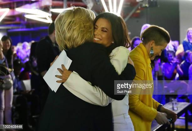 Former U.S. Secretary of State and U.S. Senator, Hillary Rodham Clinton embraces Eva Longoria during the 2020 Women at Sundance Celebration hosted by...