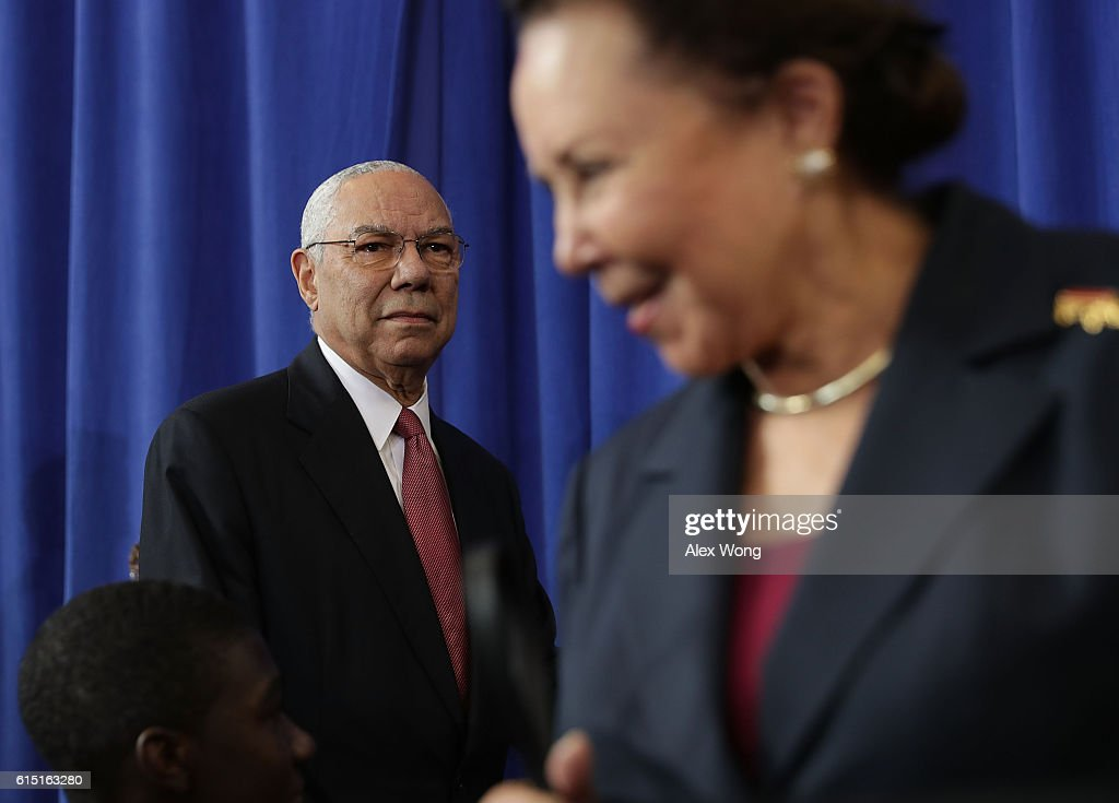 Former U.S. Secretary of State Colin Powell (L) and his wife Alma Johnson (R) arrive at an event at Benjamin Banneker Academic High School on October 17, 2016 in Washington, DC. President Barack Obama delivered remarks at the event to highlight the progress he has made to improve education across the country including a rise in high school graduation rates.