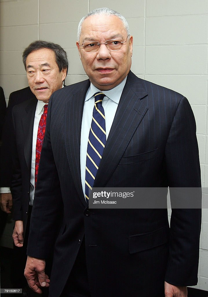 Former U.S. Secretary of State Colin Powell attends the NHL game between the New York Islanders and Carolina Hurricanes with Islanders team owner Charles Wang on January 21, 2008 at Nassau Coliseum in Uniondale, New York.