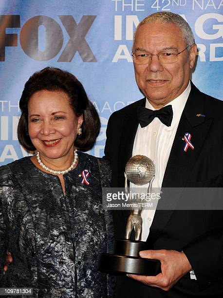 Former US Secretary of State Colin Powell winner of the President's Award and wife Alma Powell pose in the press room at the 42nd NAACP Image Awards...
