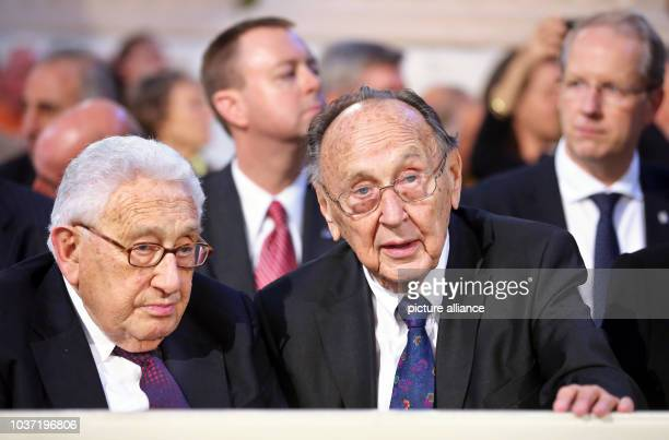 Former US Secretary of State Henry Kissinger and former German Minister of Foreign Affairs Hans-Dietrich Genscher participate in the celebrations on...