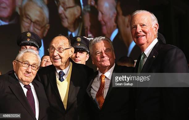 Former U.S. Secretary of State Henry Kissinger, former German Foreign Minister Hans-Dietrich Genscher, German President Joachim Gauck and former U.S....