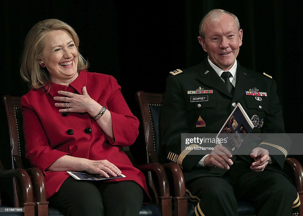 Former U.S. Secretary of State Hillary Clinton and Chairman of the Joint Chiefs of Staff Martin Dempsey laugh during remarks by U.S. Defense Secretary Leon Panetta at a presentation ceremony for the Department of Defense's highest award for public service at the Pentagon February 14, 2013 in Arlington, Virginia. Secretary Clinton recently retired from public service.