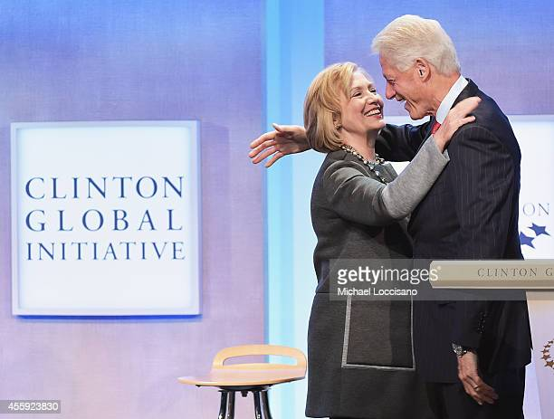 Former US Secretary of State Hillary Clinton and husband, Former U.S. President Bill Clinton embrace during the Opening Plenary Session: Reimagining...