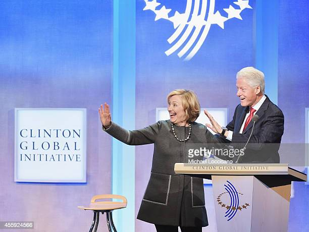 Former US Secretary of State Hillary Clinton and husband, Former U.S. President Bill Clinton address the audience during the Opening Plenary Session:...