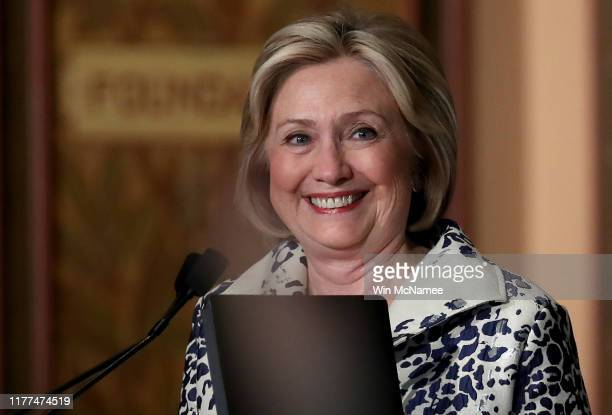 Former US Secretary of State Hillary Clinton arrives on stage before delivering remarks at Georgetown University September 27 2019 in Washington DC...