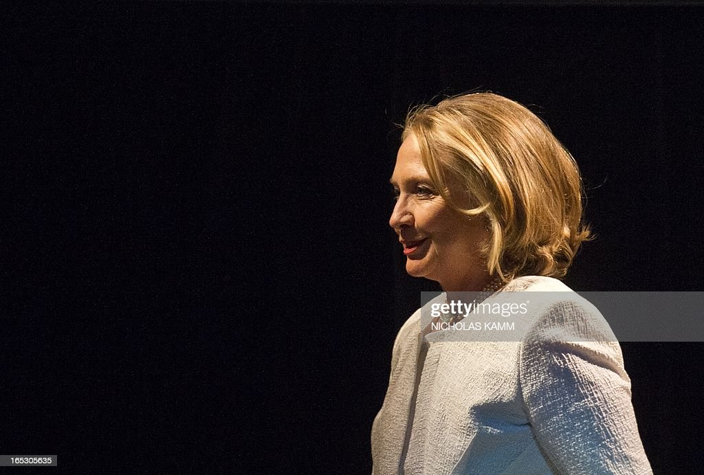 Former US Secretary of State Hillary Clinton arrives on stage to address the Vital Voices Global Awards ceremony at the Kennedy Center in Washington on April 2, 2013. The event honors 'women leaders from around the world who are the unsung heroines to strengthen democracy, increase economic opportunity, and protect human rights,' according to the group's website. AFP PHOTO/Nicholas KAMM
