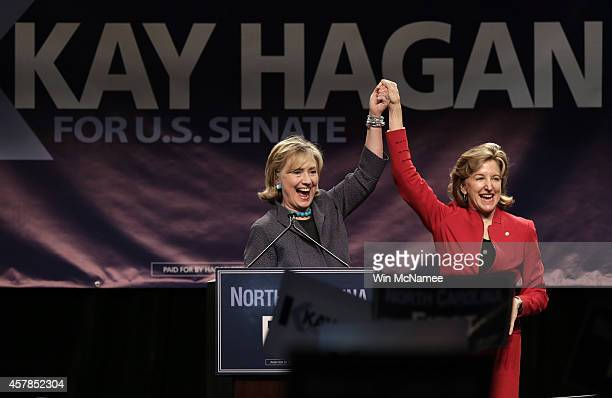Former US Secretary of State Hillary Clinton campaigns for Sen Kay Hagan at a Vote Early rally October 25 2014 in Charlotte North Carolina With ten...