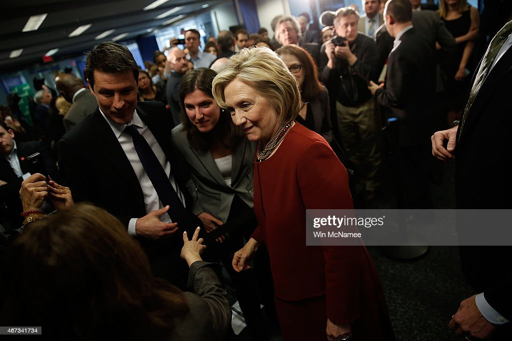 Former U.S. Secretary of State Hillary Clinton greets members of the audience after speaking at the Center for American Progress March 23, 2015 in Washington, DC. Clinton joined a panel in discussing challenges facing urban centers in the United States.
