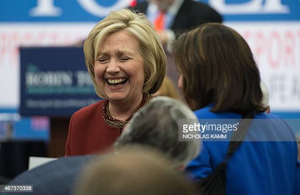 Former US Secretary of State Hillary Clinton laughs before speaking at Syracuse Universitys SI Newhouse School of Public Communications presentation...