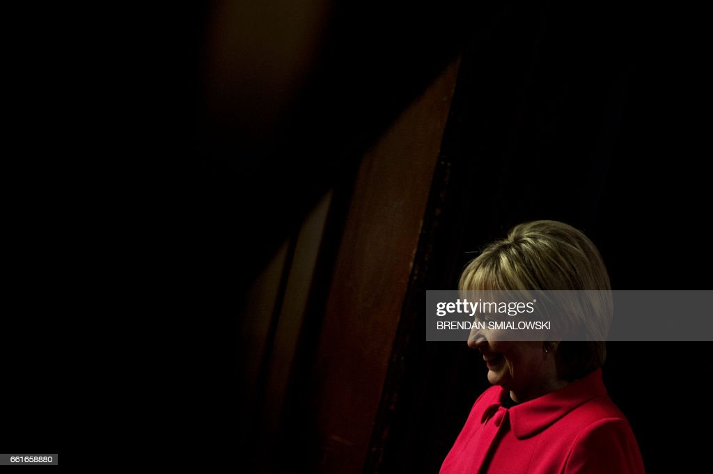 TOPSHOT - Former US Secretary of State Hillary Clinton leaves the lectern after speaking during an awards ceremony for the Georgetown Institute for Women at Georgetown University on March 31, 2017 in Washington, DC. / AFP PHOTO / Brendan Smialowski