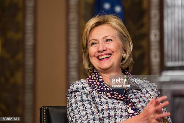 Former U.S. Secretary of State Hillary Clinton participates in a symposium on advancing the progress and freedoms of Afghan women at Georgetown...