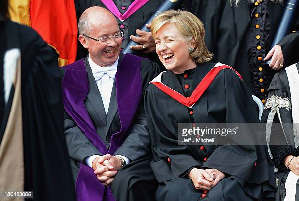 Former US Secretary of State Hillary Clinton shares a joke in St Salvator's Quad at St Andrews University on September 13 2013 in St Andrews Scotland...
