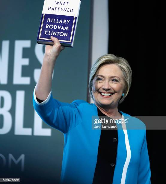 Former US Secretary of State Hillary Clinton signs copies of her book 'What Happened' at Barnes Noble Union Square on September 12 2017 in New York...