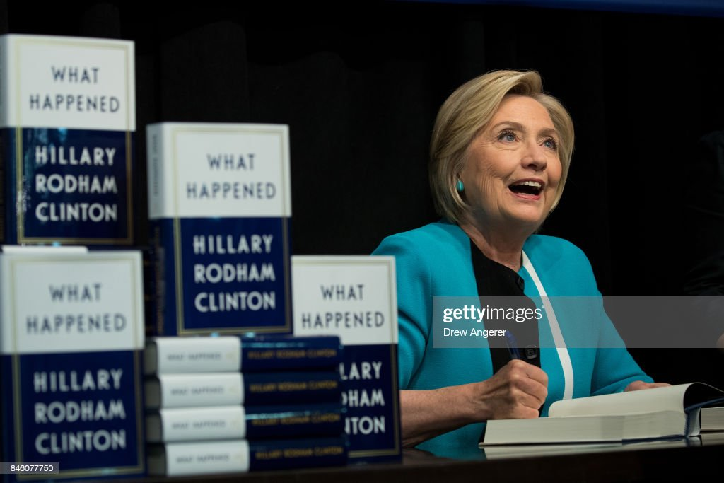 Former U.S. Secretary of State Hillary Clinton signs copies of her new book 'What Happened' during a book signing event at Barnes and Noble bookstore September 12, 2017 in New York City. Clinton's book, which focuses on her 2016 election loss to President Donald Trump, goes on sale today.