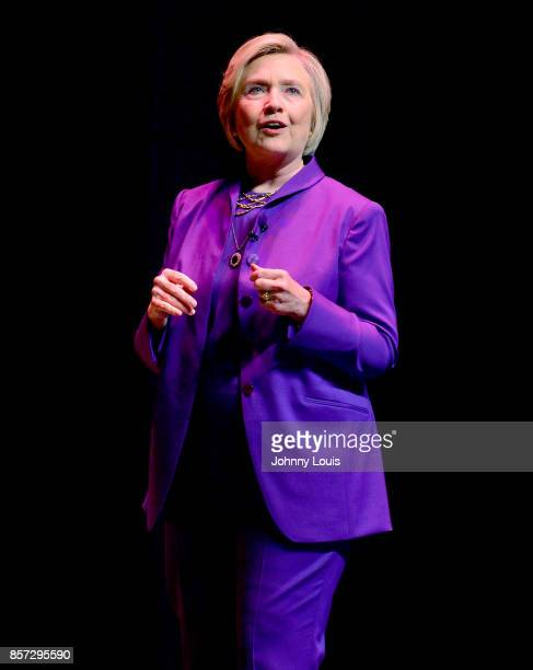 Former US Secretary of State Hillary Clinton speaks onstage during the tour for her new book 'What Happened' at AuRene Theater at Broward Center for...