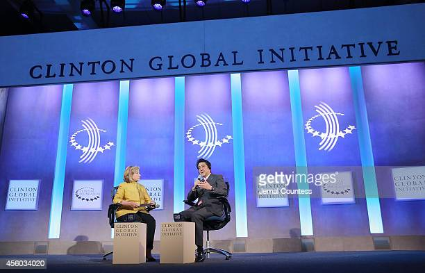 Former US Secretary of State Hillary Clinton speaks with Japanese Prime Minister Shinzo Abe onstage during the fourth day of the Clinton Global...