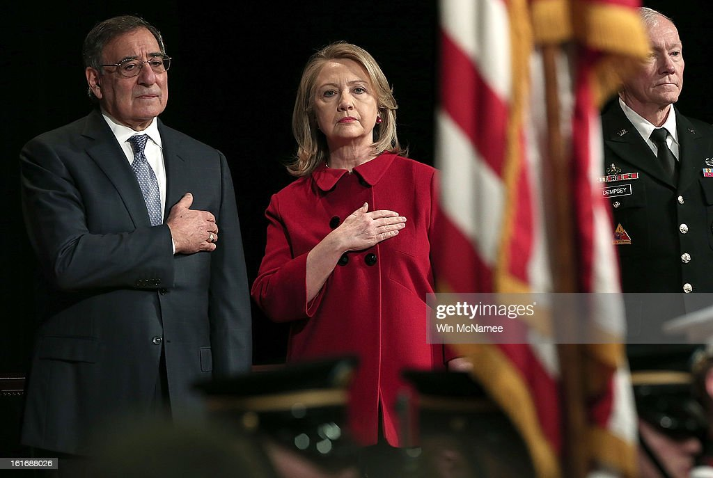 Former U.S. Secretary of State Hillary Clinton, U.S. Secretary of Defense Leon Panetta (L) and Chairman of the Joint Chiefs of Staff Martin Dempsey stand for the presentation of colors during a ceremony for the Department of Defense's highest award for public service at the Pentagon February 14, 2013 in Arlington, Virginia. Secretary Clinton recently retired from public service.