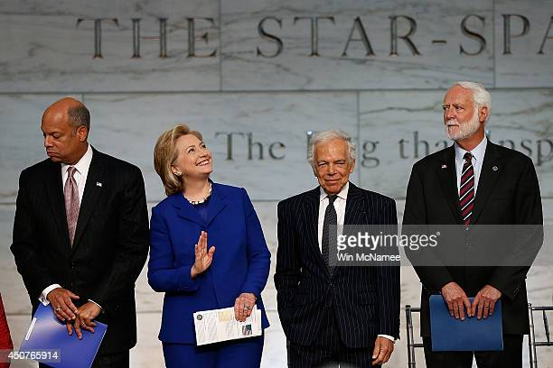 Former US Secretary of State Hillary Clinton waves to spectators during a naturalization ceremony with Ralph Lauren US Secretary of Homeland Security...