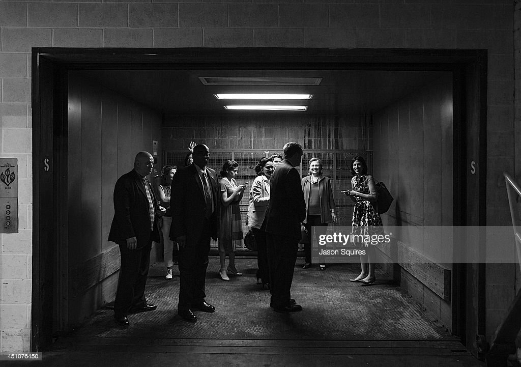 Former US Secretary of State Hillary Rodham Clinton departs with support personnel after Rainy Day Book Presents Hillary Rodham Clinton at Arvest Bank Theatre at The Midland on June 22, 2014 in Kansas City, Missouri.