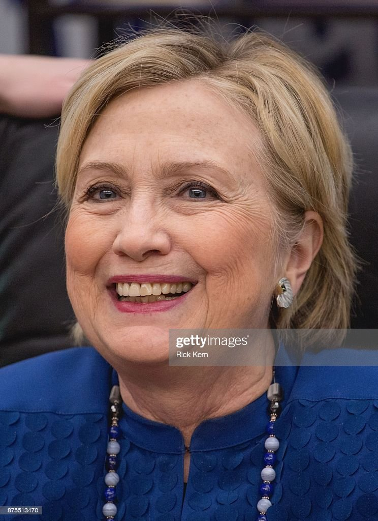 Former U.S. Secretary of State Hillary Rodham Clinton signs copies of her new book 'What Happened' at BookPeople on November 17, 2017 in Austin, Texas.