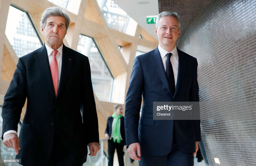 Former US Secretary of State John Kerry and French Economy Minister Bruno Le Maire arrive to attend a cession on the theme 'Green finance for a sustainable economy' which will take place on December 12, 2017 in Boulogne-Billancourt,France. Around 50 world leaders and environmental activists are attending a major climate summit in Paris called 'One Planet Summit' two years after the Paris agreement 'Cop 21'.