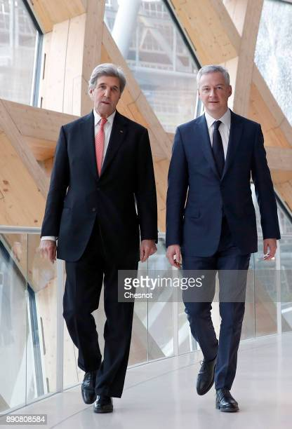 Former US Secretary of State John Kerry and French Economy Minister Bruno Le Maire arrive to attend a cession on the theme 'Green finance for a...