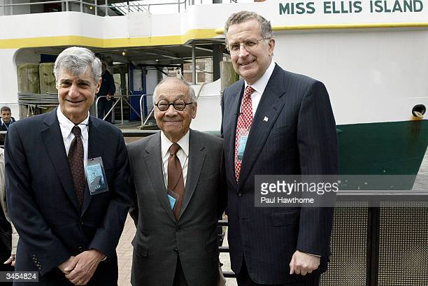Former US Secretary of the Treasury Robert Rubin architect IM Pei and National Football League Commissioner Paul Tagliabue stand together after they...