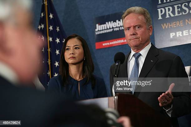 Former US Sen Jim Webb speaks as his wife Hong Le Webb listens during a news conference at the National Press Club October 20 2015 in Washington DC...