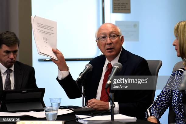 Former US Sen Ken Salazar a partner at the law firm WilmerHale showing two reports on the incident before University of Colorado President Bruce D...