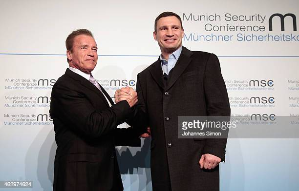 Former US senator Arnold Schwarzenegger and Vitali Klitschko lord mayor of Kiev shake hands at the 51st Munich Security Conference on February 7 2015...