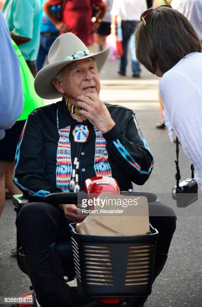 Former US Senator Ben Nighthorse Campbell pauses to talk with visitors at the Santa Fe Indian Market in Santa Fe New Mexico The annual event...