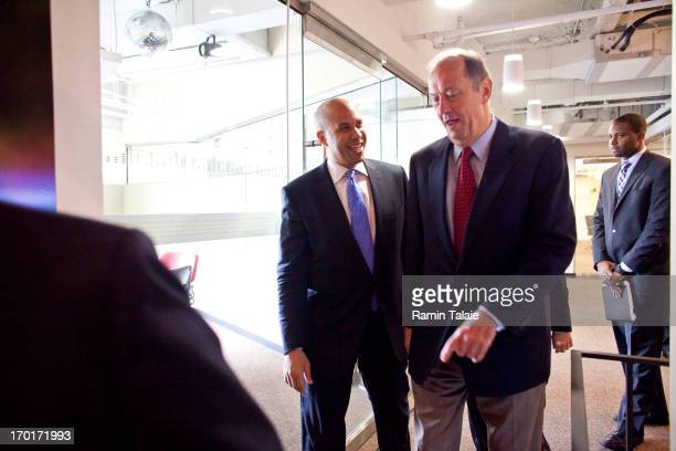 Former US Senator Bill Bradley and Newark Mayor Cory Booker arrive for a news conference to discuss his plans to campaign for the Democratic...