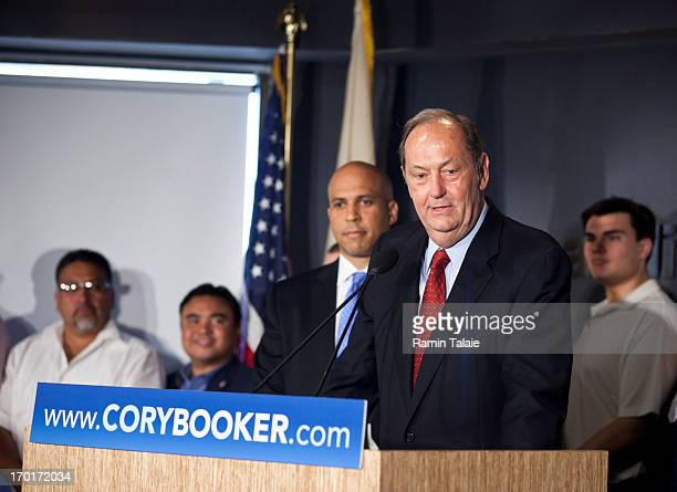Former US Senator Bill Bradley speaks as Newark Mayor Cory Booker listens during a news conference to discuss Booker's plans to campaign for the...