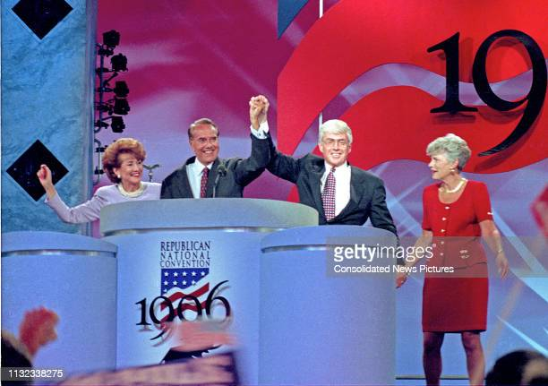 Former US Senator Bob Dole and former US Secretary of Housing and Urban Development Jack Kemp on the podium with their wives after accepting the 1996...