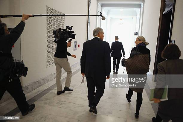 Former US Senator Chuck Hagel talks with CIA Spokesperson Mare Harf after meeting with Sen John McCain on Capitol Hill January 22 2013 in Washington...