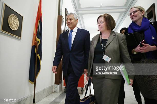 Former US Senator Chuck Hagel walks down the hallway of the Russell Senate Office Building with CIA Spokesperson Marie Harf and Assistant Secretary...