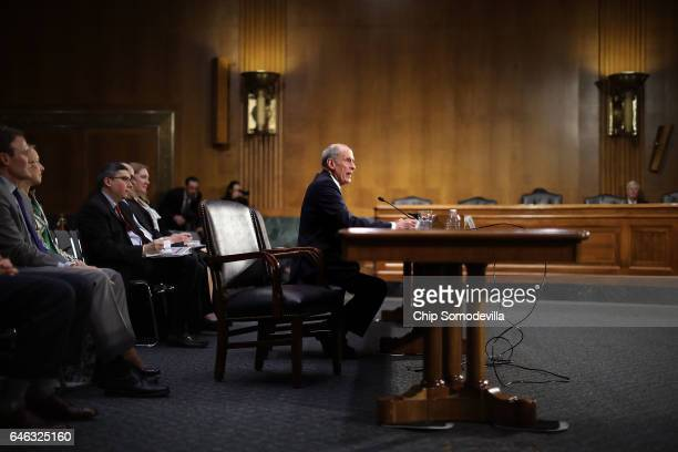 Former US Senator Dan Coats testifies during his confirmation hearing before the Senate Select Intelligence Committee to be the next Director of...