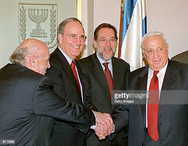 Former US senator George Mitchell second left leader of the USled commission of inquiry into IsraeliPalestinian violence accompanied by former...