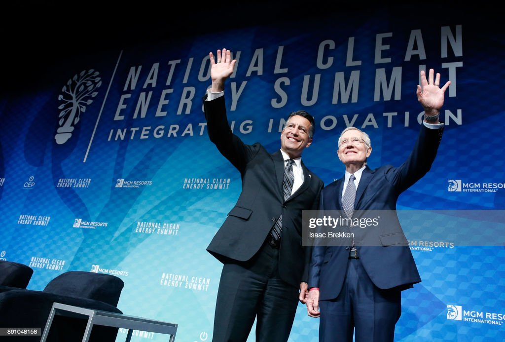 Former U.S. Senator Harry Reid (R) and Nevada Gov. Brian Sandoval pose for photos following the National Clean Energy Summit 9.0 on October 13, 2017 in Las Vegas, Nevada.