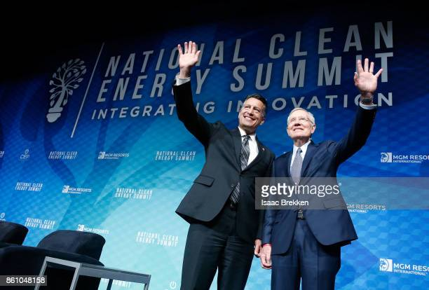 Former US Senator Harry Reid and Nevada Gov Brian Sandoval pose for photos following the National Clean Energy Summit 90 on October 13 2017 in Las...