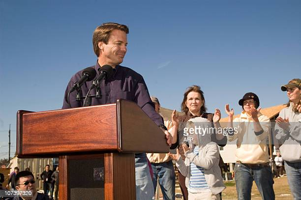 Former US senator John Edwards speaks 30 January 2008 watched by his wife Elizabeth and son Jack on Bartholomew Street in the Upper Ninth Ward in New...