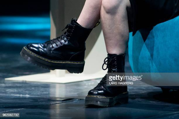 Former US soldier Chelsea Manning's boots are seen as she speaks during the C2 conference in Montreal Quebec on May 24 2018