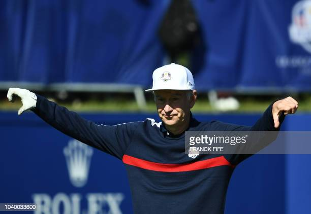 TOPSHOT Former US tennis player John McEnroe reacts during a celebrity match ahead of the 42nd Ryder Cup at Le Golf National Course at...