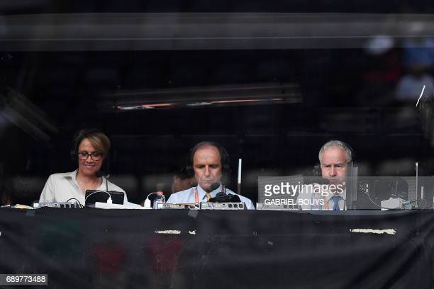Former US tennis player John McEnroe sits in a commentators booth during the tennis match between France's Kristina Mladenovic and US Jennifer Brady...